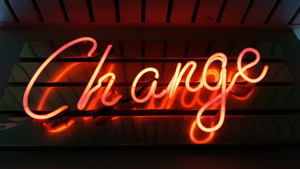 """Neon sign that reads """"Change"""" - Why Change Management is Integral to Successful Projects"""