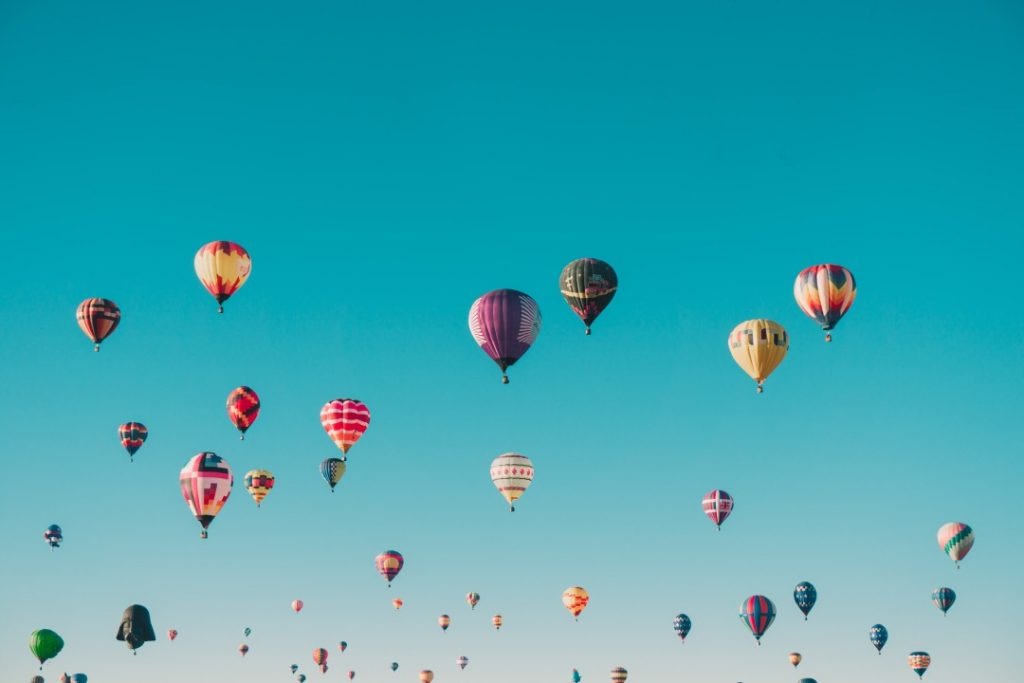 Hot air balloons floating in a blue sky. How a CIO Can Create Growth Beyond the COVID-19 Pandemic