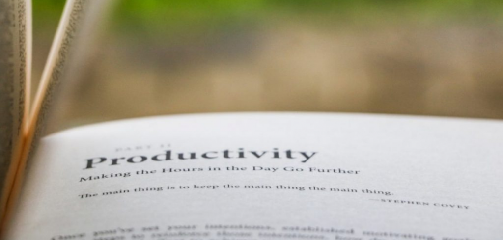 An opened book to a page about productivity. Greenery in the background. Hot to Measure and Inspire Your Teams Productivity